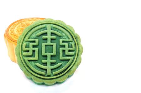 yellow  green: Chinese Moon cake green tea and durian filling on white background , for celebrate  in Mid-autumn festival Stock Photo