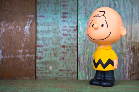 BANGKOK, THAILAND - DEC 29: Charlie Brown figure toy character from The Peanuts movie. There are plastic toy sold as part of the McDonald's Happy meals. on December 29, 2015 in Bangkok, Thailand
