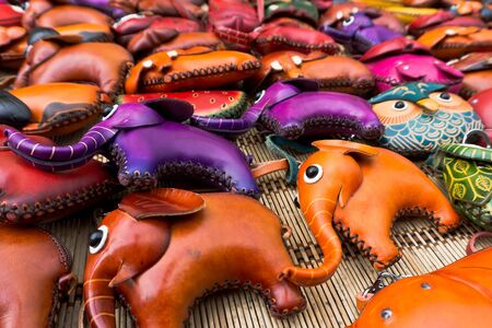 cute leather elephants and owl doll keychain Stock Photo