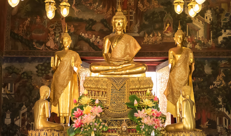 births: BANGKOK, THAILAND - JANUARY 2: Details of golden buddha statue with tales of the lord Buddhas former births behind at Wat Nairong on January 2, 2017 in Bangkok,Thailand. Editorial