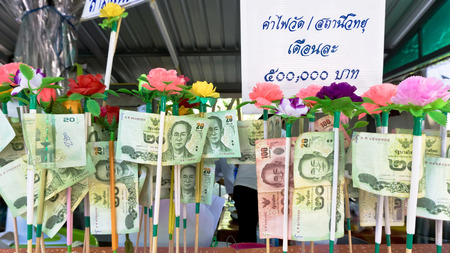 NONTHABURI THAILAND-APRIL13: Donation Merit Money Banknotes on color stick donated by visitors for maintenance the temple on April 13, 2017 in Nonthaburi,Thailand.