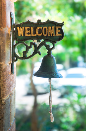 welcome tag with old bell of the house in Thailand