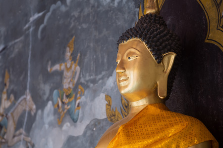 CHIANGMAI , THAILAND - JULY  26: Details of golden buddha statue with tales of the lord Buddhas former births behind at Wat Phra That Doi Suthep Temple on July 26, 2014 in Chiangmai,Thailand.