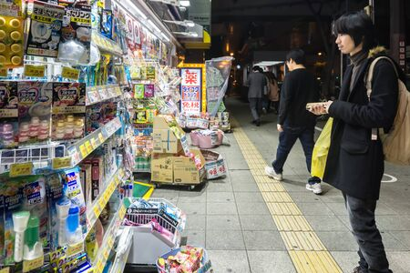 TOKYO, JAPAN - APRIL 29 : Unidentified people at convenience store. There are more 42,000 convenience stores in Japan. on April 29, 2017 in Tokyo, Japan