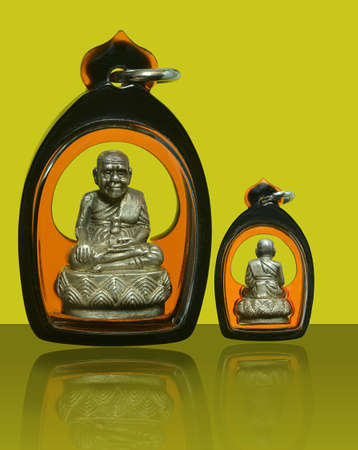 Small Buddha image or Amulet of thailand, Luang Pu Thuat on yellow background