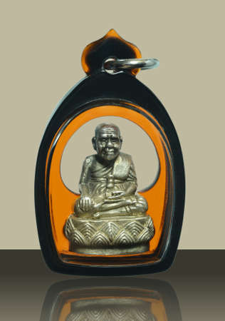 Small Buddha image or Amulet of thailand, Luang Pu Thuat on vintage background