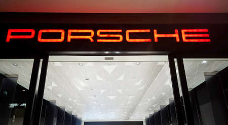 BANGKOK, THAILAND - MAY 4 : Porsche automobile dealership sign logo at ICONSIAM. The Iconsiam is the most popular shopping center in Bangkok at Bangkok, Thailand on May 4, 2019