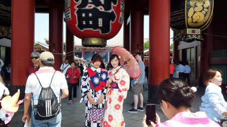 TOKYO, JAPAN - MAY 10 : Tourist wear traditional Kimono take picture with giant red lantern at Sensoji temple (Asakusa temple) the famous and oldest temple in Tokyo on May 10 , 2019 in Tokyo, Japan Editorial