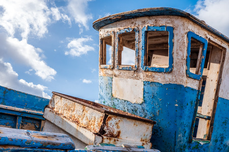 Old wooden blue ship wreck, with wheelhouse without windows Stock Photo - 103673195