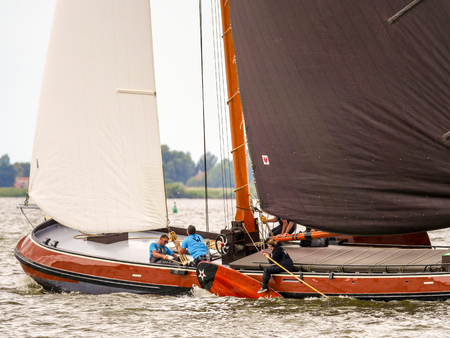 Elahuizen, The Netherlands - august 11 2017: The Skutsje of Woudsend during the annual SKS sailing competition on the Fluessen at Elahuizen in Friesland.