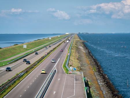 Afsluitdijk, The Netherlands - september 3 2017: The Afsluitdijk is the flood defense between Noord-Holland and Friesland, which closes off the IJsselmeer from the Wadden Sea. Stockfoto - 111978880
