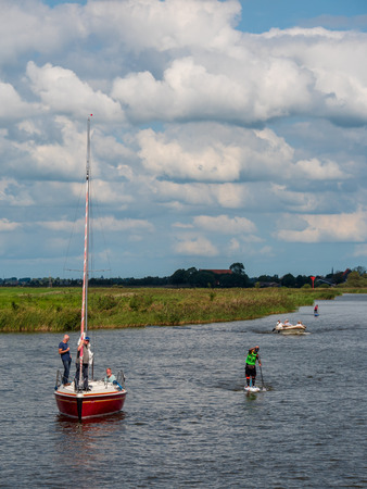 Woudsend, The Netherlands - september 1 2018: 11-city SUP (Stand Up Paddle) tour, the ultimate 220 kilometer challenge in Friesland. Editorial