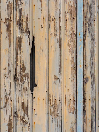 Old and weathered wooden door with peeling paint Stock Photo