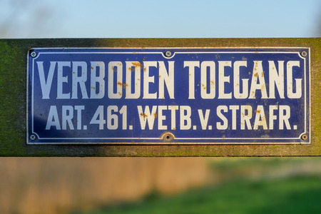 Sign with the Dutch text 'verboden toegang' ('prohibited entry') and the reference to the article in the Criminal Code