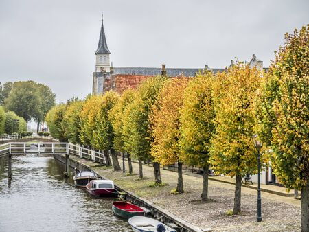 Street scene in the fall of the historic city of Sloten in the province of Friesland, one of the smallest cities in the Netherlands, it is a former fortress. 版權商用圖片