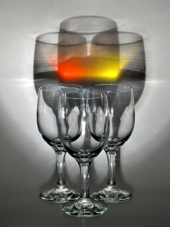 Three wine glasses under some interesting light