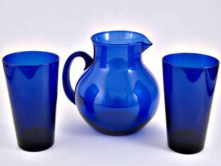 A blue pitcher and glass set