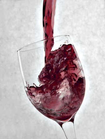 Pouring red wine into a wine glass