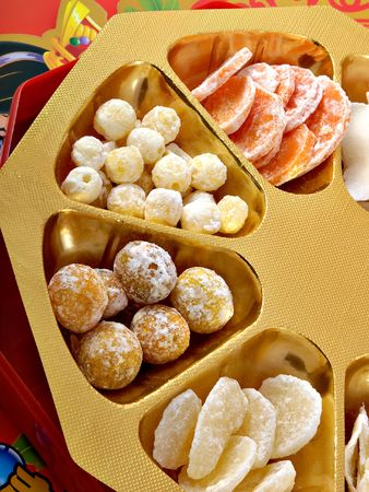 cumquat: Some Chinese New Year candies on a gold and red background
