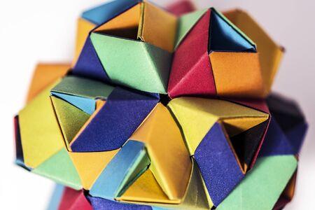 Multicolored origami paper work macro closeup