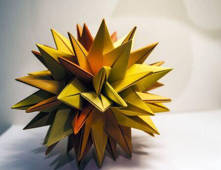 Colorful origami paper orange and green star