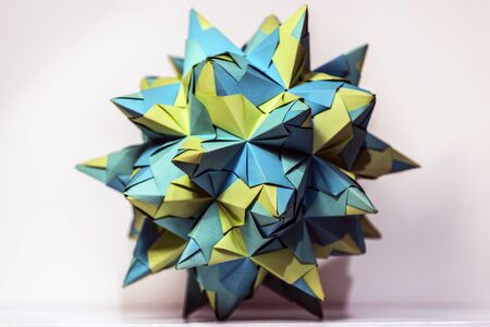 Green origami paper star