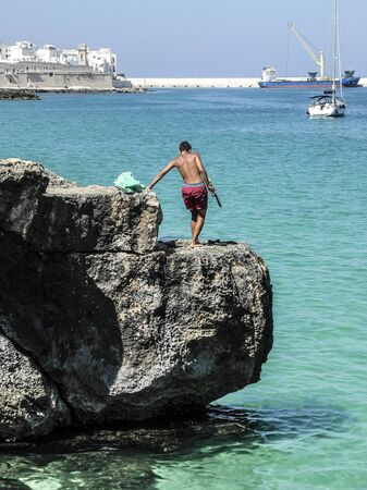 unafraid: Young boy on the cliff