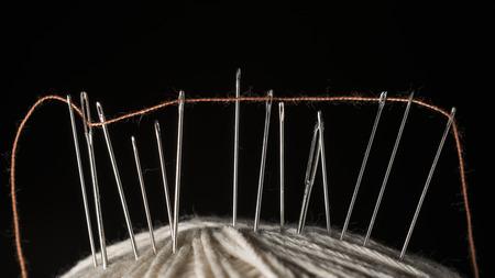 Needles and thread Stock Photo