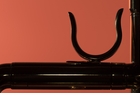 Brass trumpet thumb ring backlight closeup Stock Photo