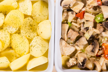 chooped cooked mushroom with a pepper and potatoes in food trays