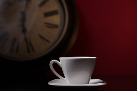 cup of coffee with clock with red background photo