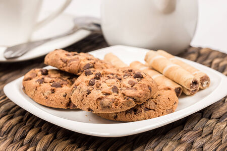Coffee with milk and chocolate cookies and wafles photo