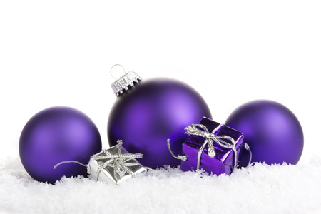 Christmas balls purple with presents on white background