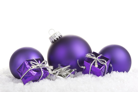 Christmas balls purple with presents on white background photo
