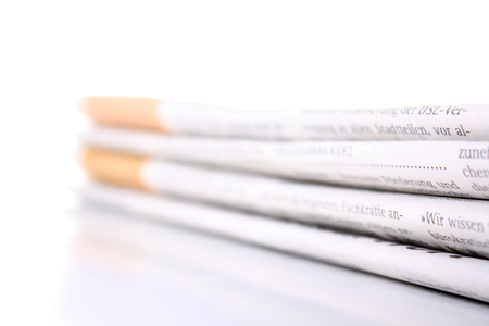 periodicals: several newspaper stacked with a white background