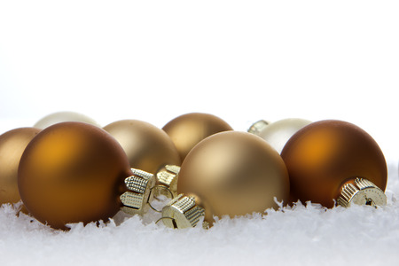 christmas, creme christmas balls on artificial snow with white
