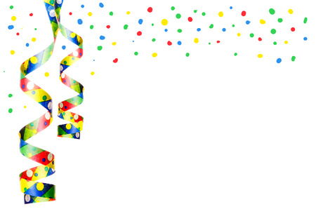streamers and confetti as decoration for parties, sylvester isolated, hanging with white background photo