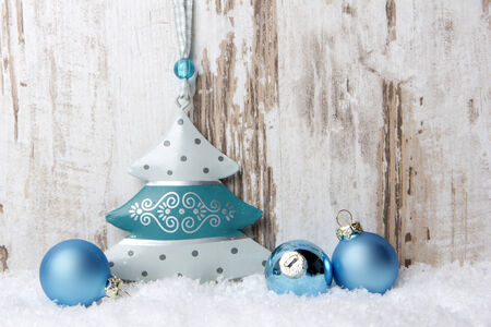 Christmas decoration with wood background, snow, christmas balls and christmas tree turquoise photo