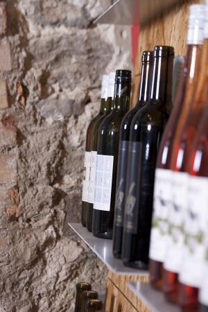 Wine bottles on a shelf in a wine shop