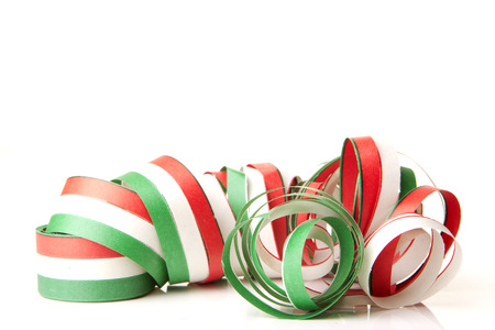 streamers and confetti as decoration for parties, sylvester with white background  photo