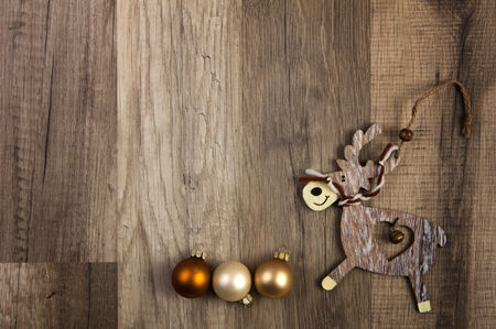 deterministic: christmas baubles brown, moose on wooden background  Stock Photo