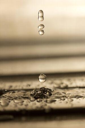The fluid motion of water splashing as it is poured   Standard-Bild