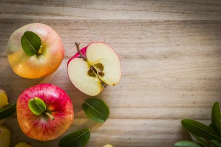 Apple top view with wooden background left side Reklamní fotografie