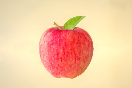 Fresh apple in yellow background