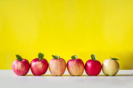 Fresh apples in yellow background