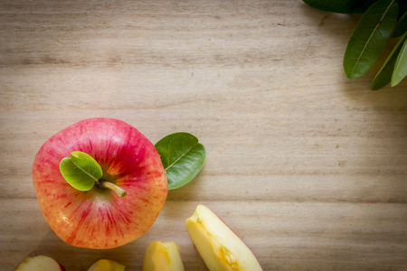 Apple top view with wooden background