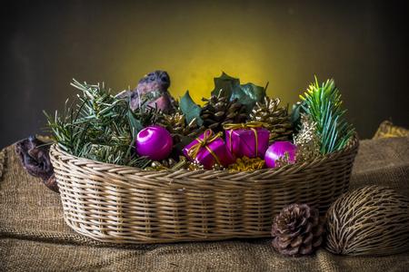 Christmas elment in basket on dark background Reklamní fotografie