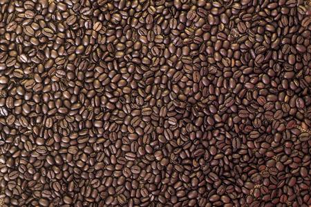 Coffee beans pattern background gold and dark Reklamní fotografie
