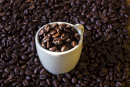 Coffee beans in coffee white cup