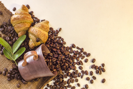 Coffee cup and Croissant on beans and white bckground Reklamní fotografie